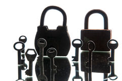 Old rusty padlocks and keys on white background. Mirror.  Stock Images