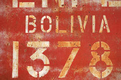 Old rusty painted metal wall with inscriptions Stock Images