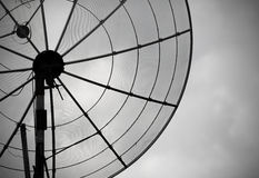 Old parabolic antenna on sky background Royalty Free Stock Photo