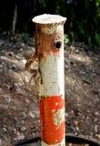 An old rusty parking bollard royalty free stock photos