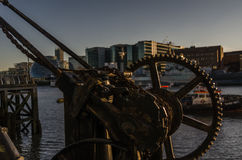 Old rusty parts of the coastal crane on the banks of the river i Royalty Free Stock Photo