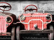 Old and rusty pedal cars for kid Stock Photography