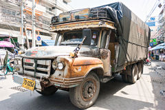 Old rusty pickup truck on a city street Thailand Stock Photos