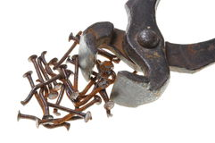 Old rusty pincers and nails Royalty Free Stock Photography
