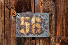 Old rusty plate with house number Stock Photo