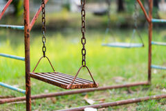 Old rusty playground swing in the park Royalty Free Stock Photos
