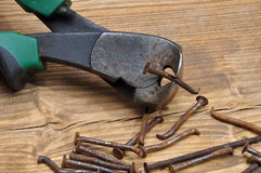 Old rusty pliers and nails Stock Photography