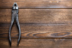 Old rusty pliers on wooden Stock Images