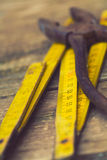 Old rusty pliers and wooden meter Royalty Free Stock Photos