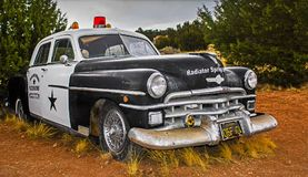 OLD, RUSTY POLICE CAR - ROUTE 66, ARIZONA, USA. stock photography
