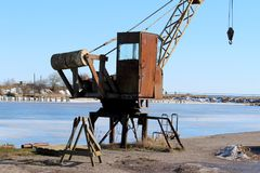 A old crane. Old rusty port crane in winter stock images