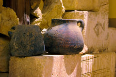 Old rusty pottery. On the sandstone bricks Royalty Free Stock Photos