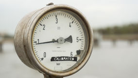 An old rusty pressure gauge which has been calibrated. Royalty Free Stock Photography