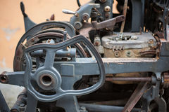 Old rusty printing machine complex mechanism of metal Stock Photography