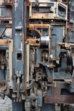 Old rusty printing machine complex mechanism of metal Royalty Free Stock Image