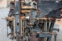 Old rusty printing machine complex mechanism of metal Royalty Free Stock Images