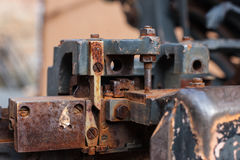 Old rusty printing machine complex mechanism of metal Stock Photos