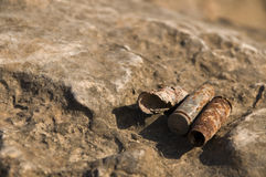Old rusty projectile cartridges Royalty Free Stock Images