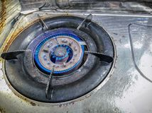 Old Rusty Propane Counter-top Gas Stove with Blue Flames.  stock photos