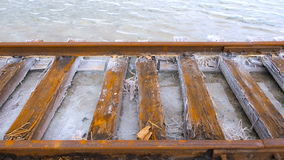 Old rusty rails and sleepers covered with salt. Lake baskunchak. Corrosion on the rails of the railway. Over salar stock footage