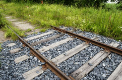 Old rusty rails, sleepers and grass Stock Images