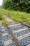 Old rusty rails, sleepers and grass Stock Photo