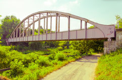 Old rusty railway bridge over the footpath in Hungary Royalty Free Stock Photos
