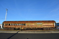 Old rusty railway carriage. Side view of an old and rusty railway carriage pictured in Astoria, Oregon, U.S.A stock image