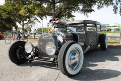 Old Rusty Rat Rod. Parked outdoors on a sunny day. frontal side view. Miami, Florida Stock Photography