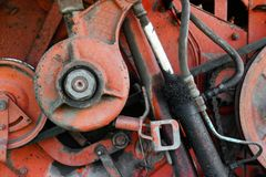 Old rusty red oily machinery. Conceptual closeup Royalty Free Stock Photography