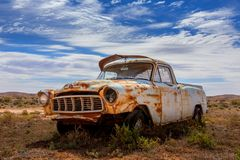 Old rusty relic car in Australian outback. An old rusting relic of a ute left in scrub of Australian outback desert stock images