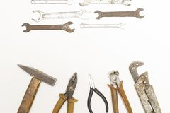 Old rusty repair tools on white. Background stock photos