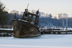 Old rusty rescue boat froze in the ice. Of the Southern Bug River royalty free stock photos
