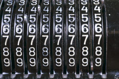 Old rusty retro calculator black standing on a wooden table Royalty Free Stock Photos