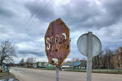 Old Rusty Road Sign Consumed by the Time Stock Image