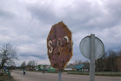 Old Rusty Road Sign Consumed by the Time Royalty Free Stock Photo