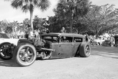 Old Rusty Rod car. Old Rusty Rat Rod driven outdoors on a sunny day around other classic cars. monochrome in black and white Stock Photography