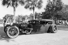 Old Rusty Rod car. Old Rusty Rat Rod driven outdoors on a sunny day around other classic cars. monochrome in black and white Royalty Free Stock Photography