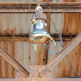 Old rusty roof lamp with broken glass and chords Stock Photo