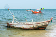 Old rusty rowboat for fishing parking near the beach Stock Image