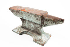 Old rusty rugged anvil foundry isolated white. Royalty Free Stock Photos