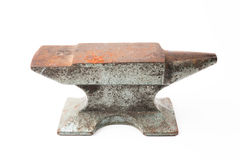 Old rusty rugged anvil foundry isolated white. Stock Image
