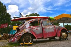 Old rusty 60`s Volkswagen with a paddle board Stock Photography