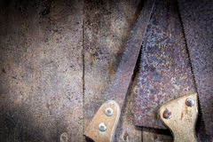 Old rusty saw blades on a wooden table Royalty Free Stock Photo