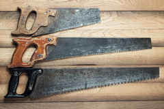 Old rusty saws on table Stock Photography