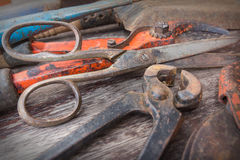 Old rusty scissor, shears and pincer - vintage gardening tools on wooden background Royalty Free Stock Image