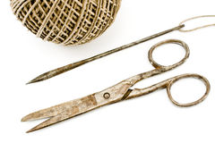 Old rusty scissors and needle - sewing tools Royalty Free Stock Photography