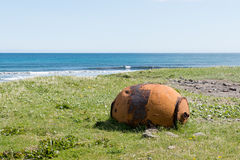 Old rusty sea mine on the Faroe Islands Stock Photography