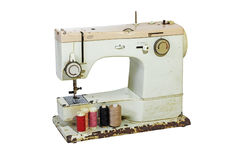 Old Rusty Sewing Machine with Colored Cottons Stock Image