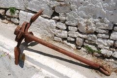 Old rusty ship anchor in Greek street Royalty Free Stock Photography